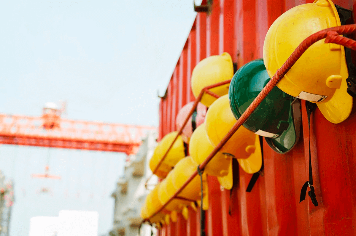 hard hats lined up at Lean construction site