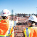 Construction workers looking at a job site - Touchplan